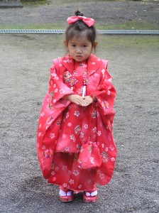 3 yr.old Japanese girl making her first visit to Shrine for New Years in a kimono.